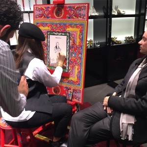 Painter and portraits in Dolce & Gabbana store